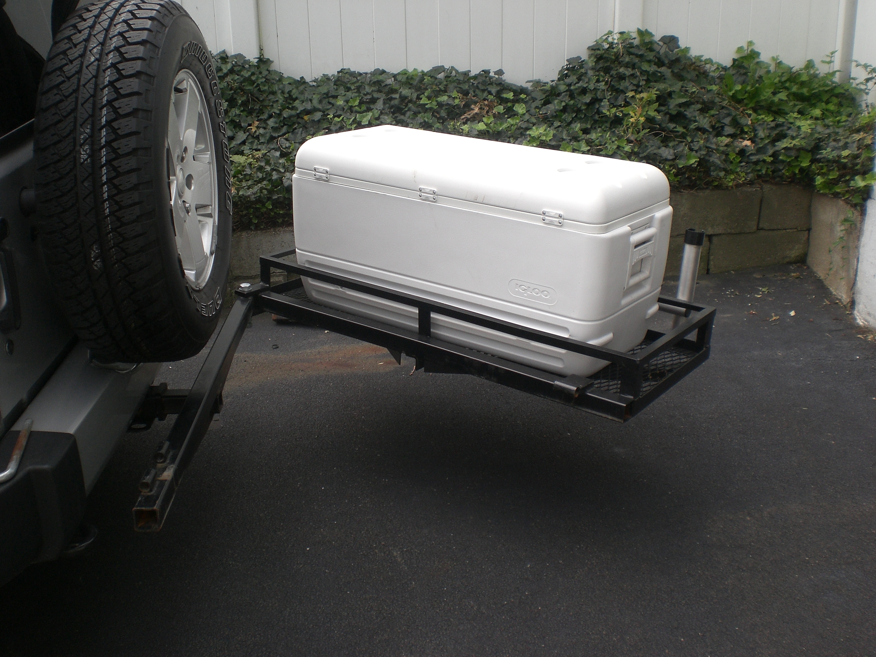 Pic request please jk wranglers with cooler racks for Jeep fishing rod holder