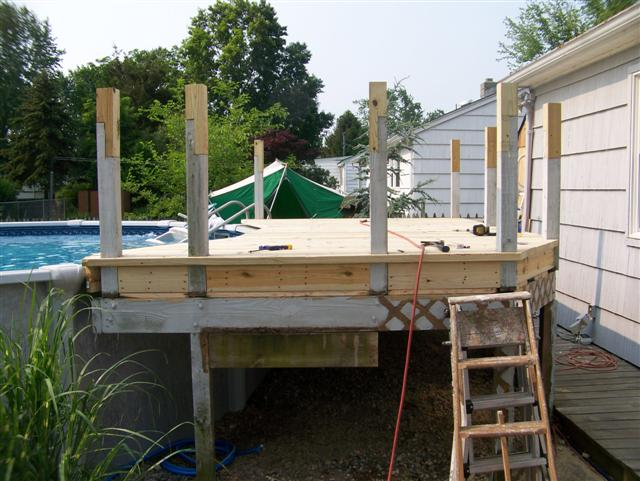 Deck around above ground pool new pool higher what to do for Above ground pool metal decks