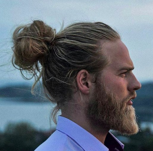 A-photograph-of-a-hipster-male-with-the-perfect-man-bun-hairstyle-placed-on-the-vertex-area-of-his-head-and-styled-with-long-wavy-hair.jpg